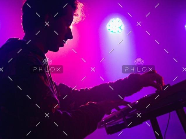demo-attachment-30-man-holding-dj-mixer-machine-2350325